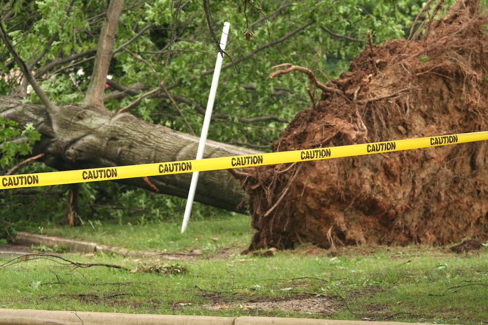 Caution tape blocking storm damage